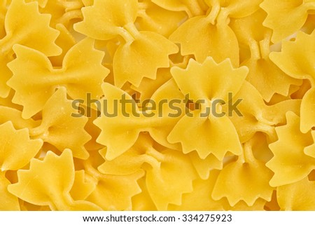 pasta farfalle texture or background macro - stock photo