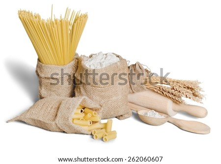 Pasta. Flour, cereals, pasta in a canvas bag and ear on white background.  - stock photo