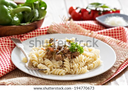Pasta fusilli with bolognese sauce and parmesan - stock photo