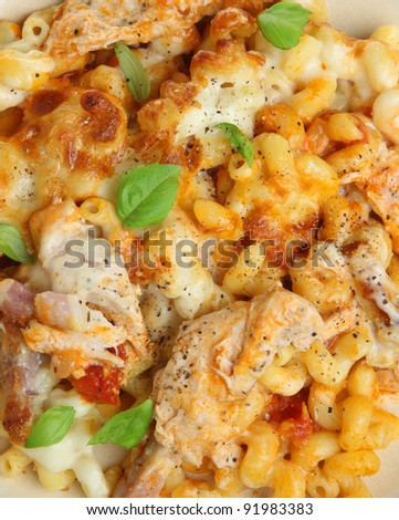 Pasta gratin with chicken and bacon - stock photo