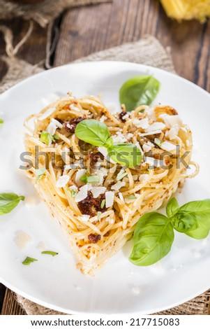 Pasta Heart (Spaghetti with Tomato Pesto, Basil and Parmesan Cheese) - stock photo