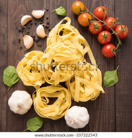 Pasta ingredients. tomato, garlic, pepper, and mushroom on wooden background. - stock photo