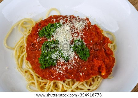 Pasta Napoli with parmesan cheese and tomato sauce - stock photo