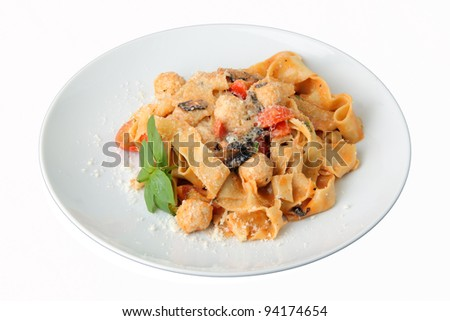 Pasta pappardelle with chicken noisettes and parmesan on white dish isolated on a white background - stock photo