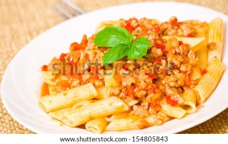 Pasta penne bolognese - stock photo