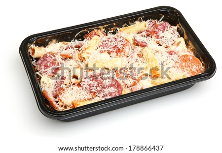 Pasta ready meal with salami sausage, ham and cheese - stock photo