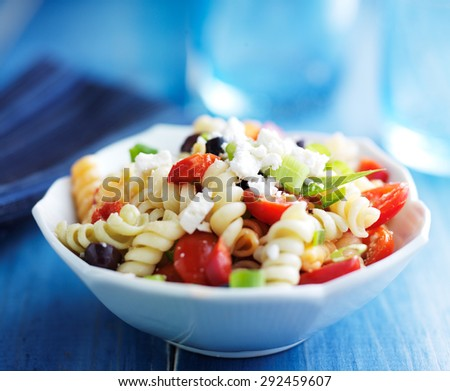 pasta salad with olives and feta cheese - stock photo