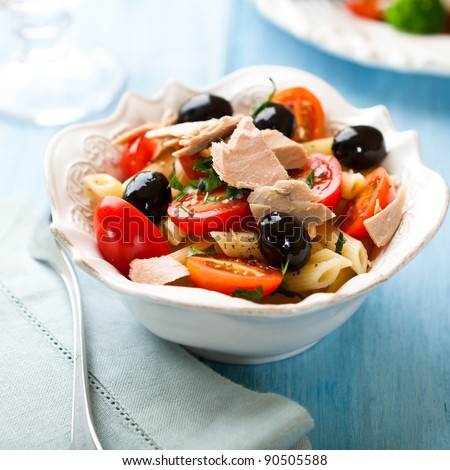 Pasta salad with tuna and black olives - stock photo