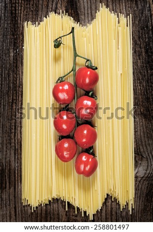 Pasta spaghetti tomato and spices, on wooden table - stock photo