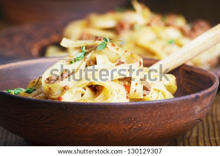pasta tagliatelle with bolgnese sauce on the wooden table - stock photo
