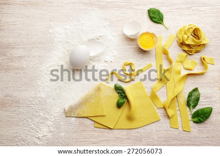 pasta with basil on white wood background,  products for making lasagna and other pasta - stock photo
