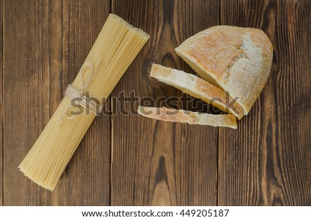 Pasta with bread, horizontal. On the wooden table - stock photo