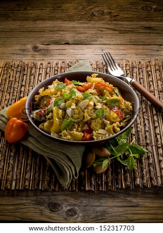 pasta with capsicum zucchinis and sliced almond - stock photo