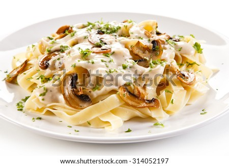 Pasta with champignons and sauce - stock photo