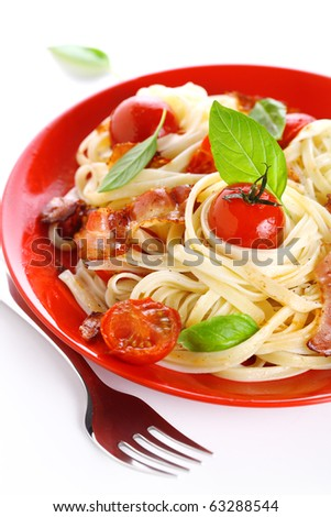 Pasta with cherry tomato and bacon - stock photo