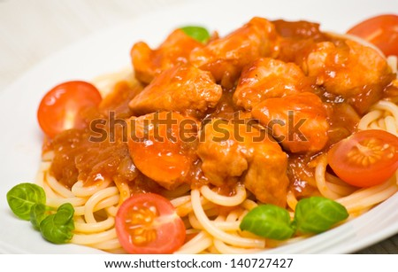 pasta with chicken breast in tomato sauce - stock photo