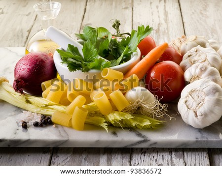 pasta with ingredients over marble - stock photo