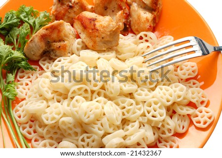 Pasta with meat and parsley on orange plate - stock photo