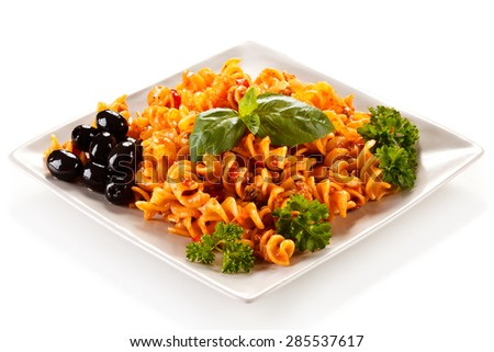 Pasta with meat, tomato sauce and vegetables on white background ( shallow DOF ) - stock photo
