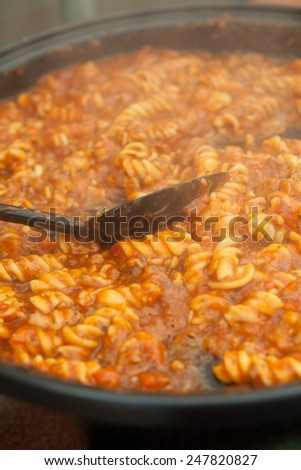 Pasta with mince beef and tomato sauce on a big frying pan. Spaghetti bolognese, macro perspective, nobody, Italian food.  - stock photo