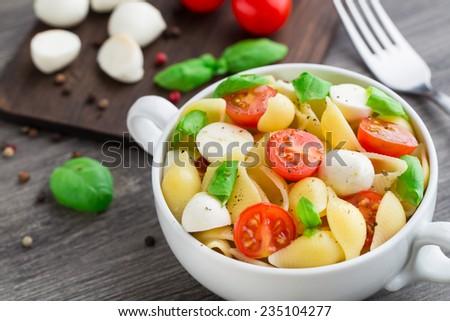 Pasta with mozzarella and tomato - stock photo