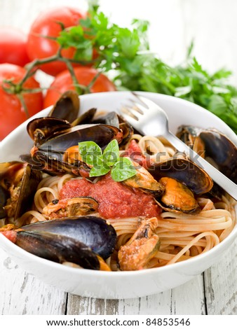 pasta with mussel and tomato sauce - stock photo