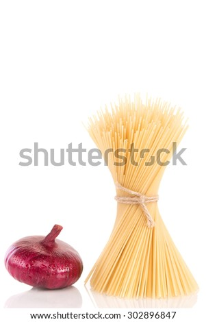 Pasta with one onion - stock photo