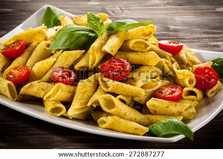 Pasta with pesto sauce and vegetables - stock photo