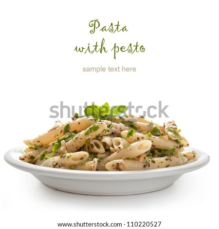 Pasta with pesto sauce, fresh basil and nuts on white plate - stock photo