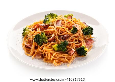 Pasta with pesto sauce, ham, Parmesan and broccoli  - stock photo