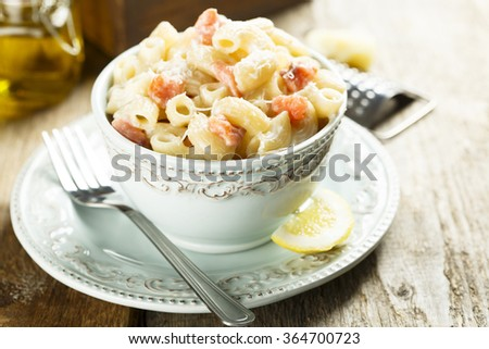Pasta with salmon and cream - stock photo