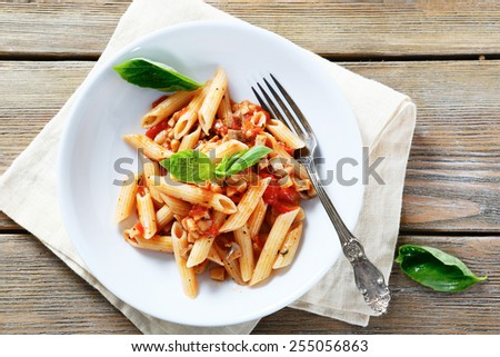 pasta with sauce and mushrooms in a bowl, food closeup - stock photo