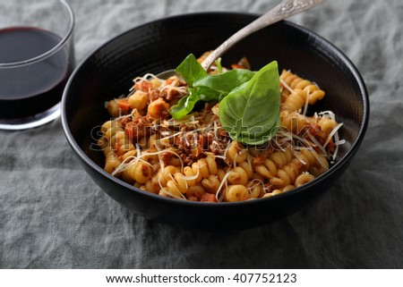 pasta with sauce bolognese and basil, closeup - stock photo