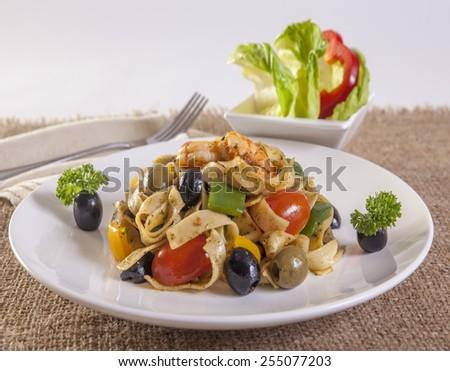 pasta with shrimps, black olives   - stock photo