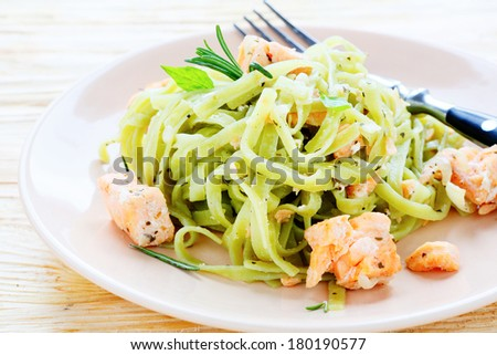 pasta with spinach and salmon, food closeup - stock photo