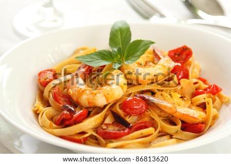 Pasta with tomato and prawn - stock photo