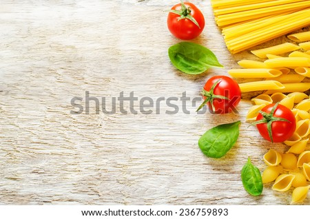 pasta with tomato and shpinat on white wood background. tinting. selective focus - stock photo