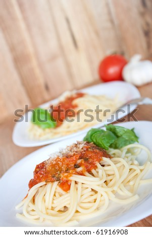 Pasta with tomato sauce and grated parmesan cheese. Shallow depth of field. - stock photo