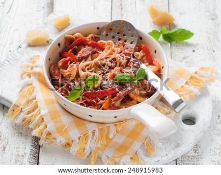 Pasta with tomato sauce and pepper, selective focus - stock photo