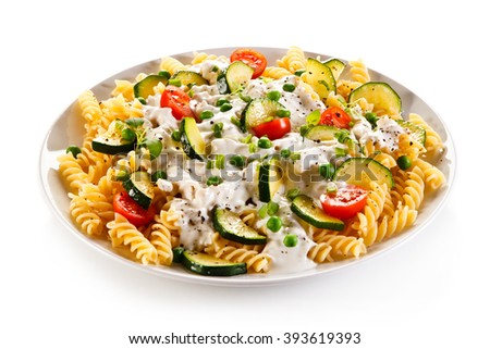 Pasta with white sauce and vegetables - stock photo