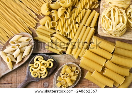 Pasta  word with wood background - stock photo