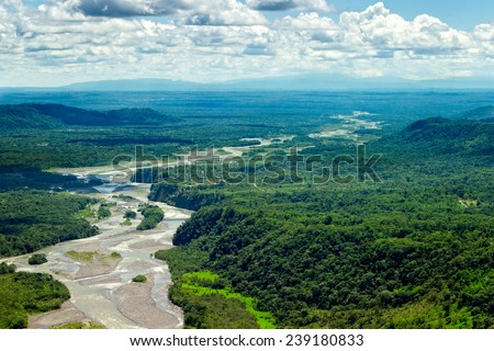 PASTAZA RIVER BASIN AERIAL, SHOT FROM LOW ALTITUDE FULL SIZE HELICOPTER  - stock photo