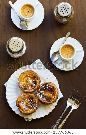 Pasteis de Nata or Portuguese Custard Tarts with Espresso - stock photo