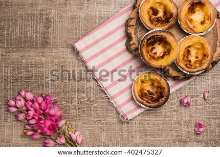 Pasteis de nata, typical Portuguese egg tart pastries from Lisbon on a set table. Top view with copy space - stock photo