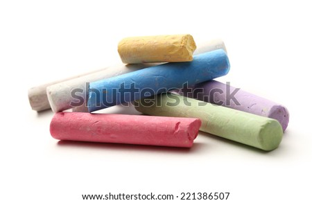 Pastel chalks in heap on white - stock photo