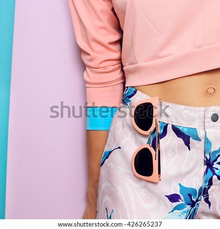 Pastel Colored clothing. Fashion Accessories Sunglasses. Summer vanilla style. - stock photo