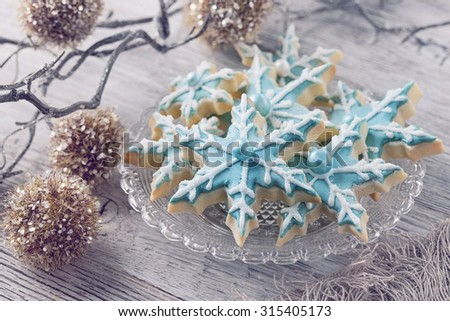 Pastel colored cookies on a wooden background - stock photo