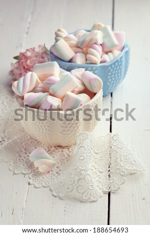 Pastel colored marshmallows in bowls, toned photo  - stock photo