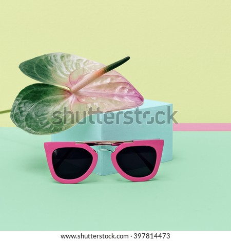 Pastel Colors Summer trend. Fashionable Pink Sunglasses. - stock photo