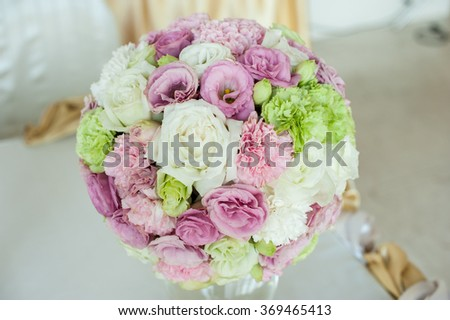 Pastel colors wedding bouquet made of Roses, Freesia, Carnation and Limonium flowers, wedding bouquet with rose bush, Ranunculus asiaticus - stock photo